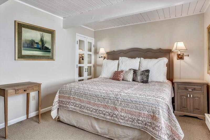 bed at aspen chateau condo rental with neutral bedding